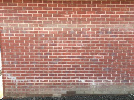 Garage Wall Before Brick Cleaning